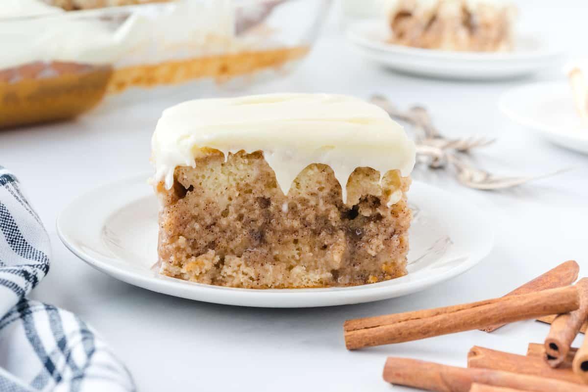 cinnamon roll poke cake slice on plate