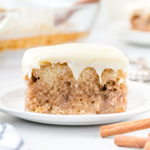 cinnamon roll poke cake square featured