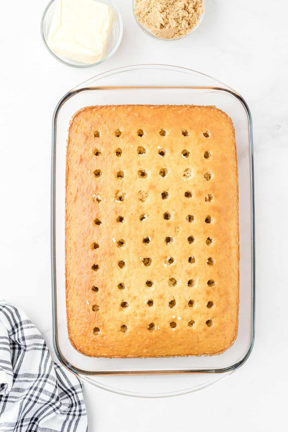 cinnamon roll poke cake with holes