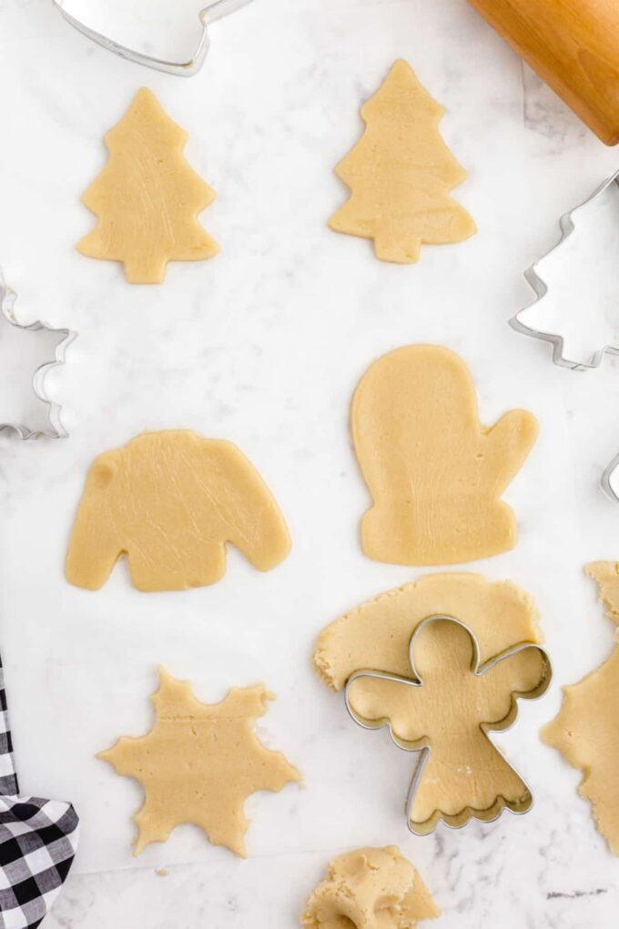 cookie dough in christmas shapes