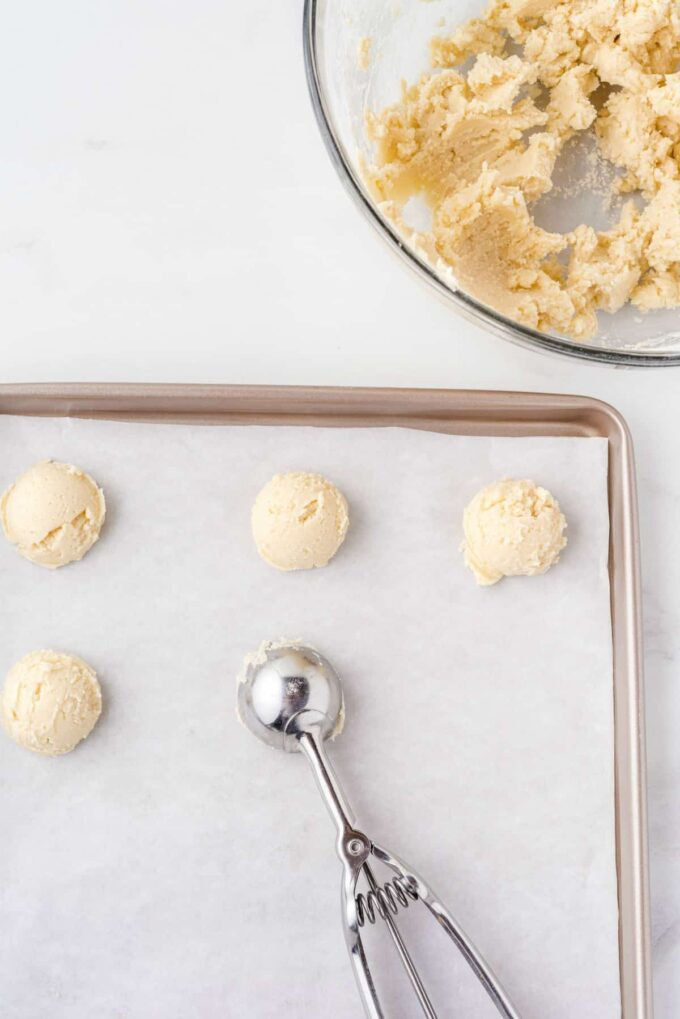 cookie scoops on a cookie sheet