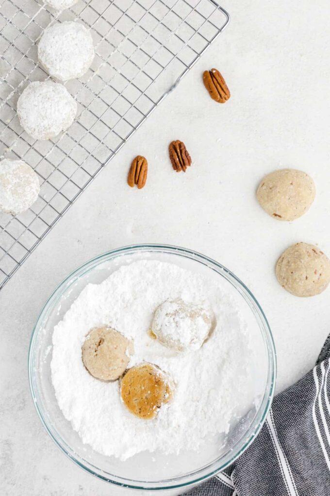 roll cookies in powdered sugar