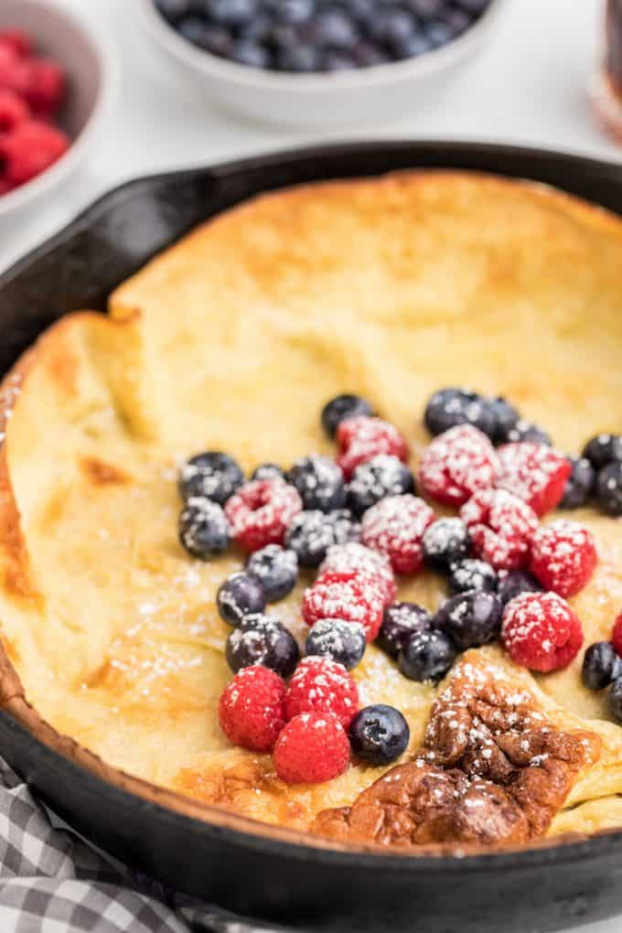 Dutch Baby Pancakes with fruit in a skillet
