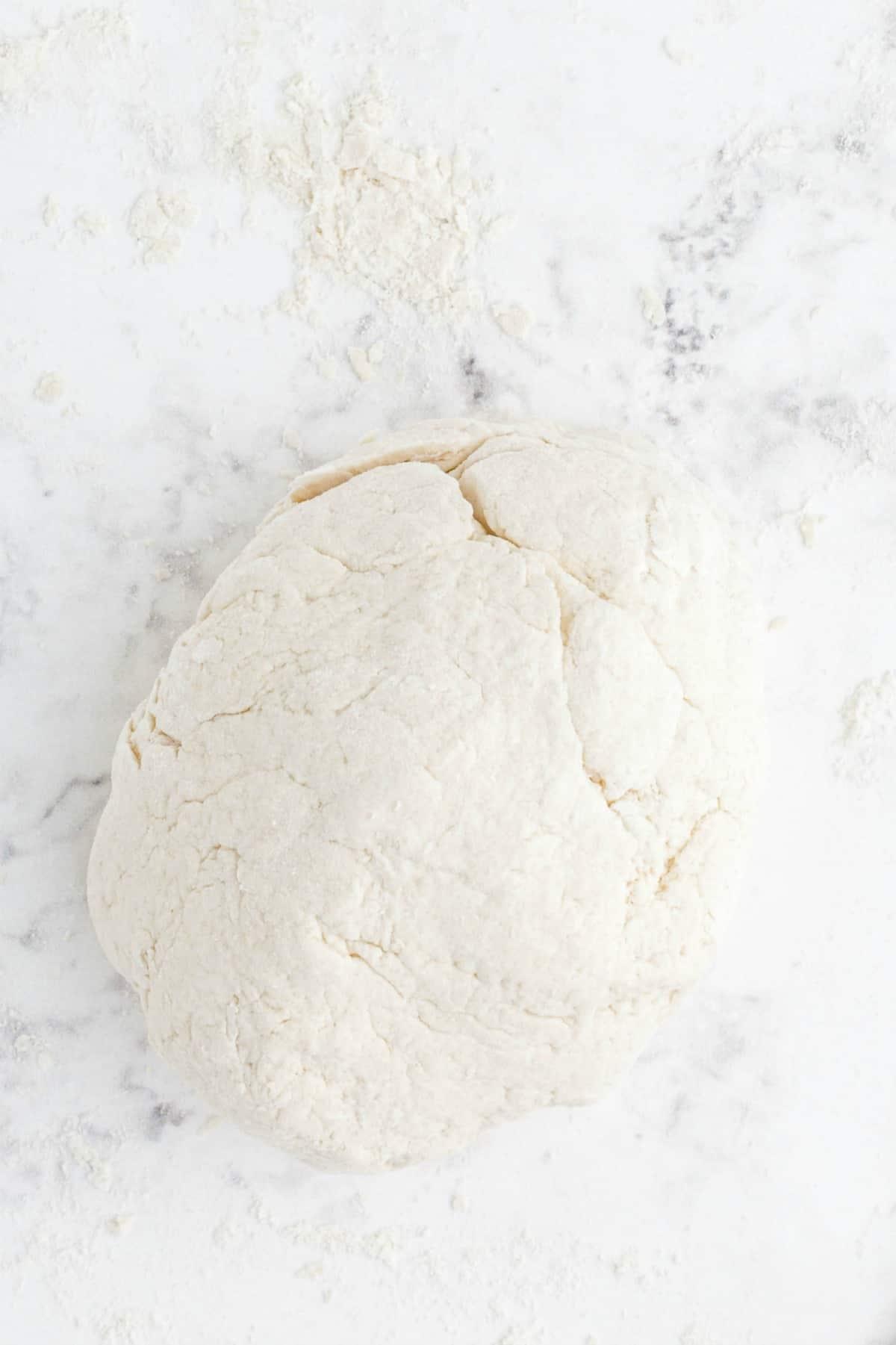 kneed flour into dough