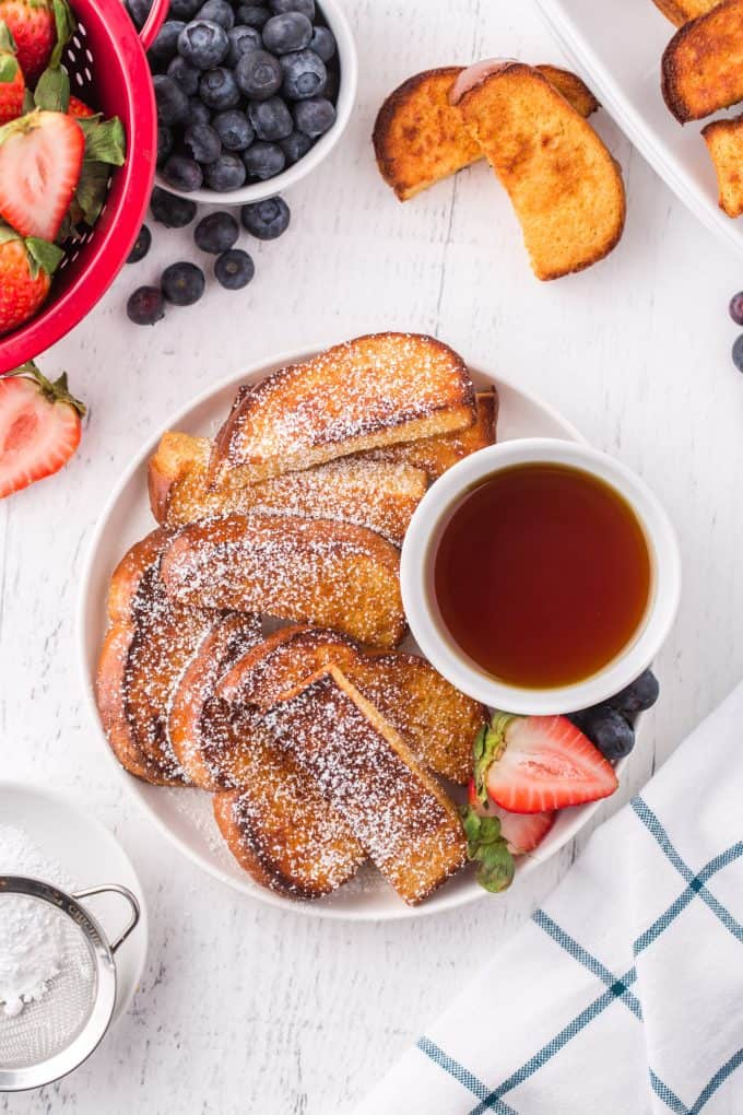 French toast sticks on a plate with syrup