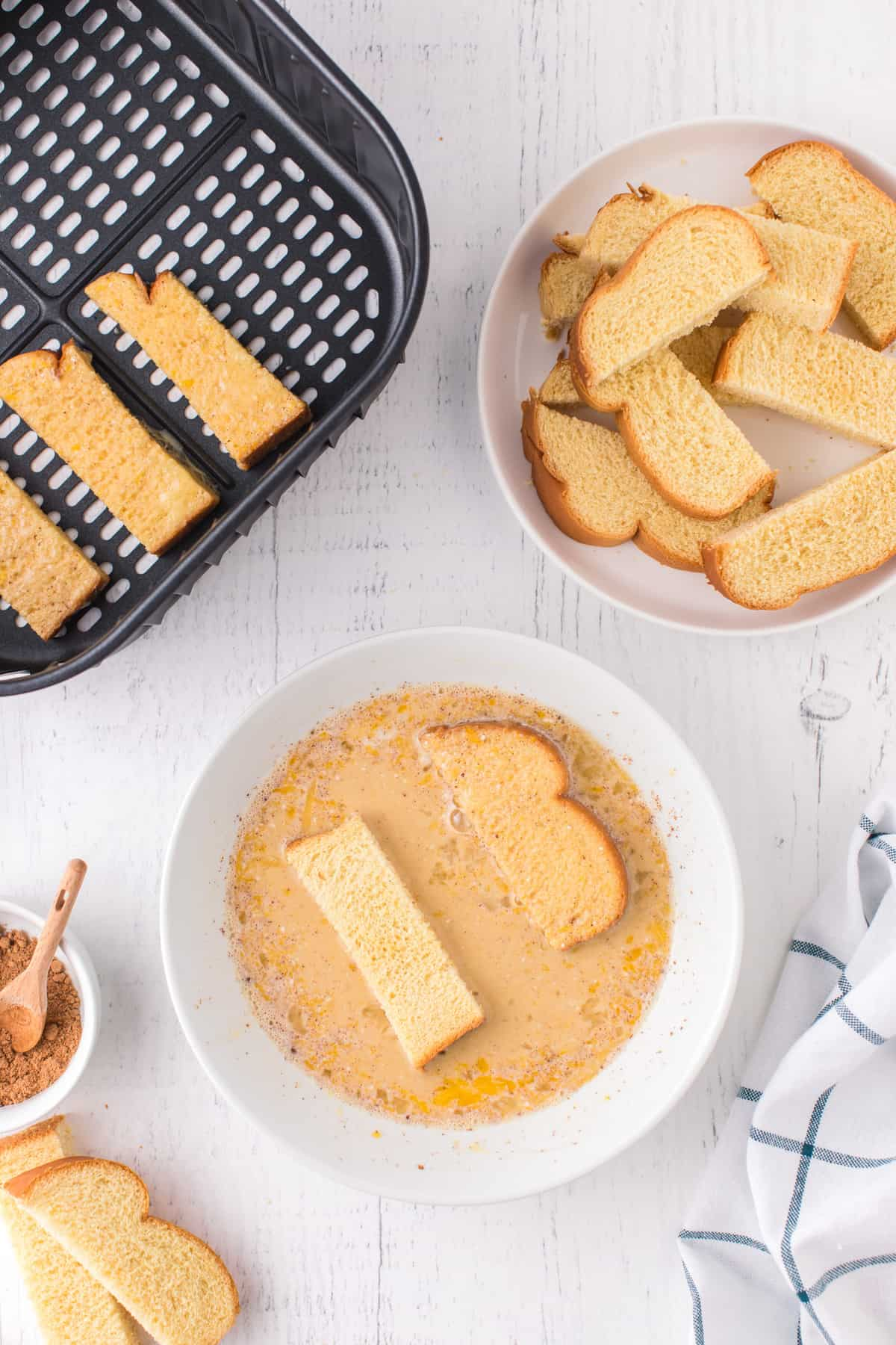 Air Fryer French Toast Sticks dunk in egg mixture