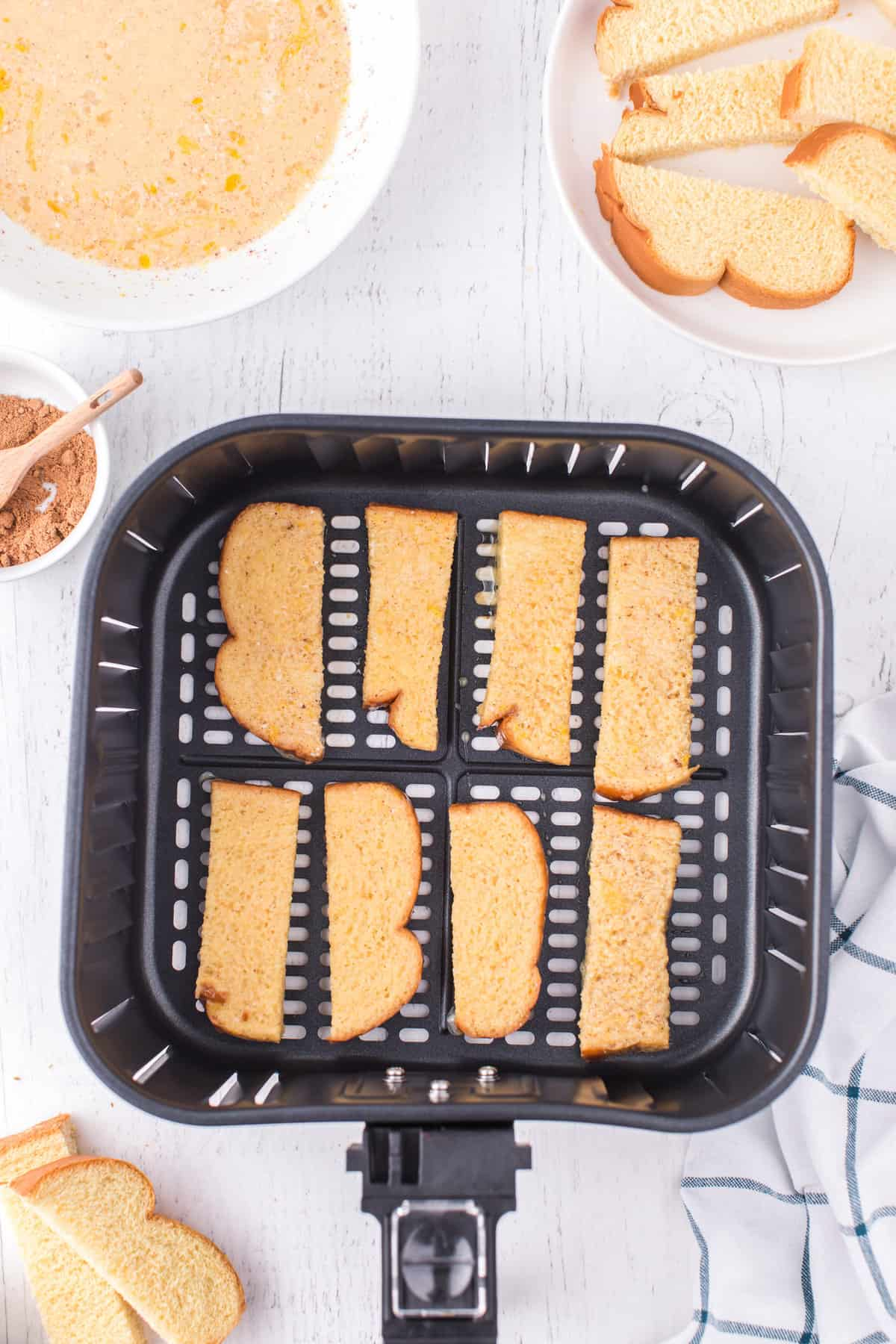 Air Fryer French Toast Sticks stacked in air fryer