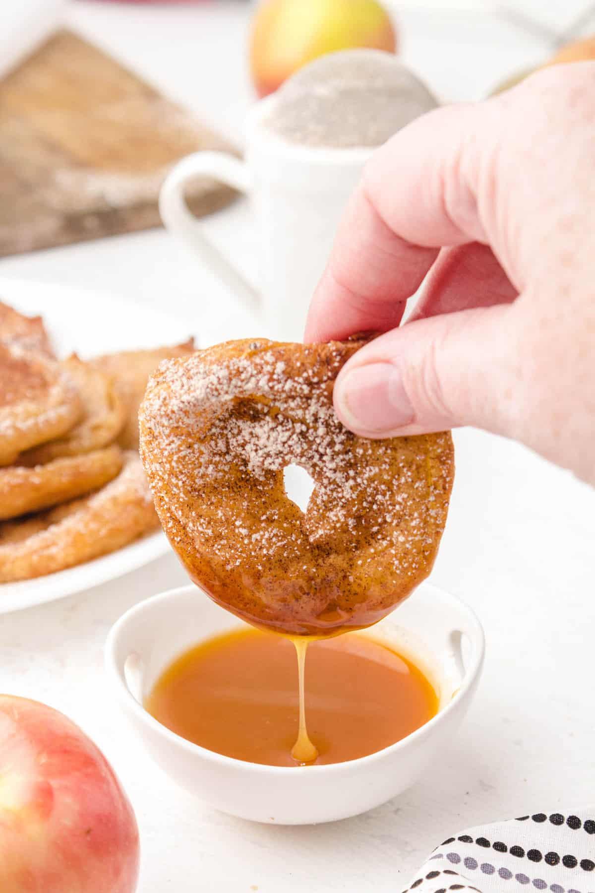 apple fritter rings dipped in caramel sauce