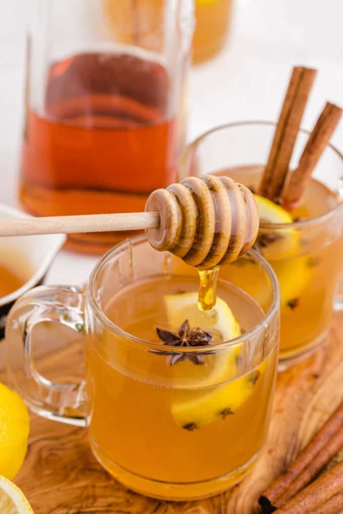 Honey dripping into a Classic Hot Toddy