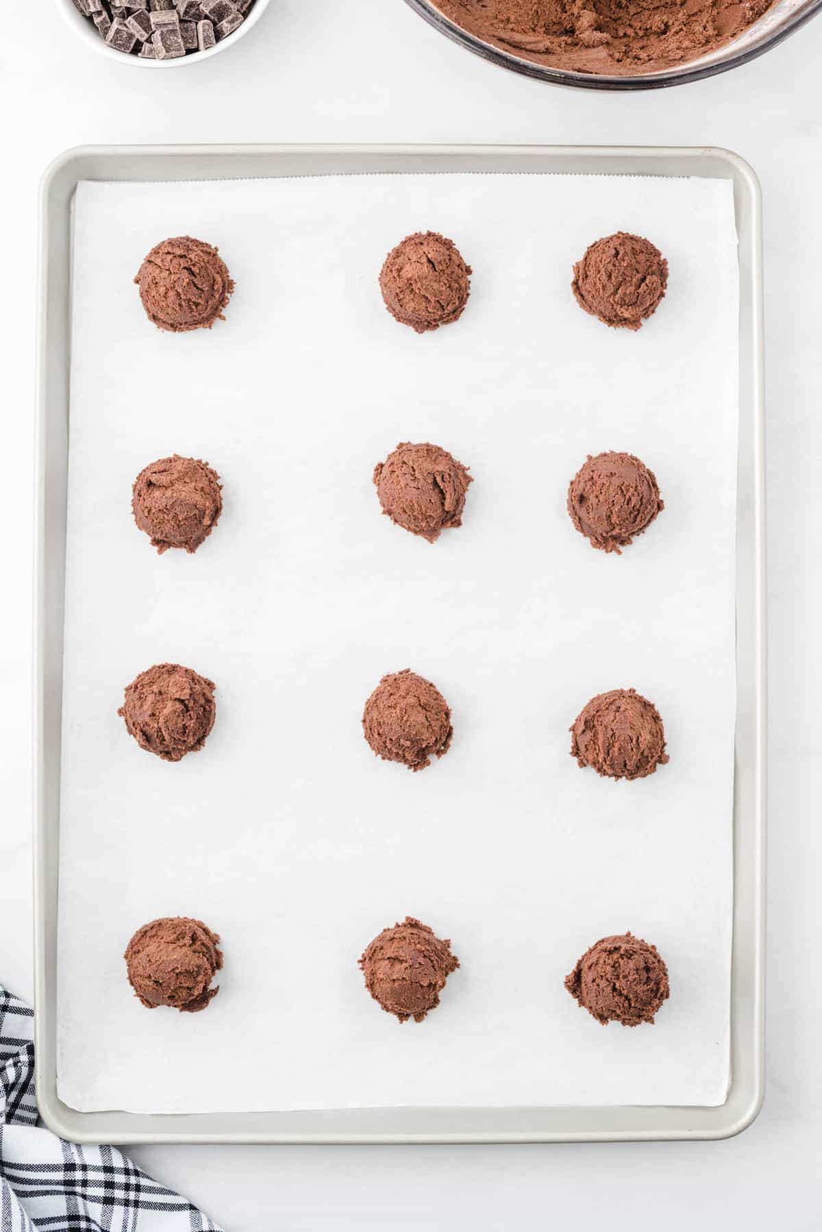 hot chocolate cookie dough on cookie sheet