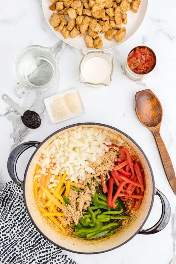 bell peppers, onion, fajita seasoning in a pot