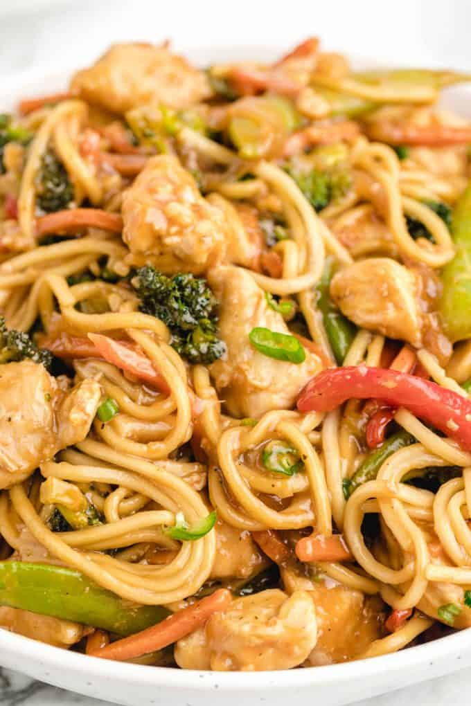 close up of Chicken Lo Mein noodles with chicken and veggies