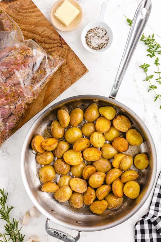 saute potatoes in a skillet