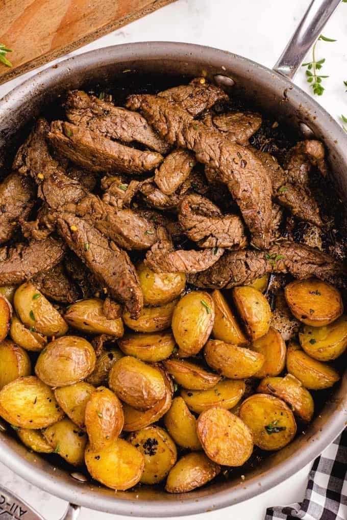 garlic butter steak and potato skillet in a pan