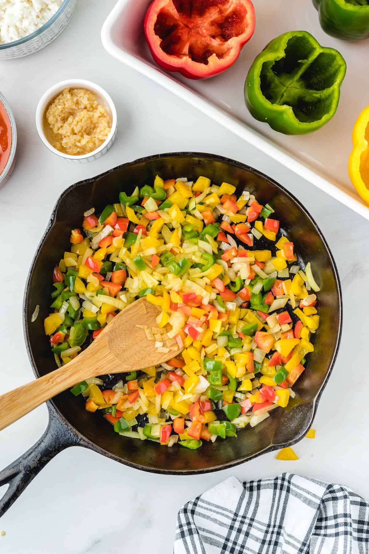 olive oil, diced onion, pepper tops in a skillet