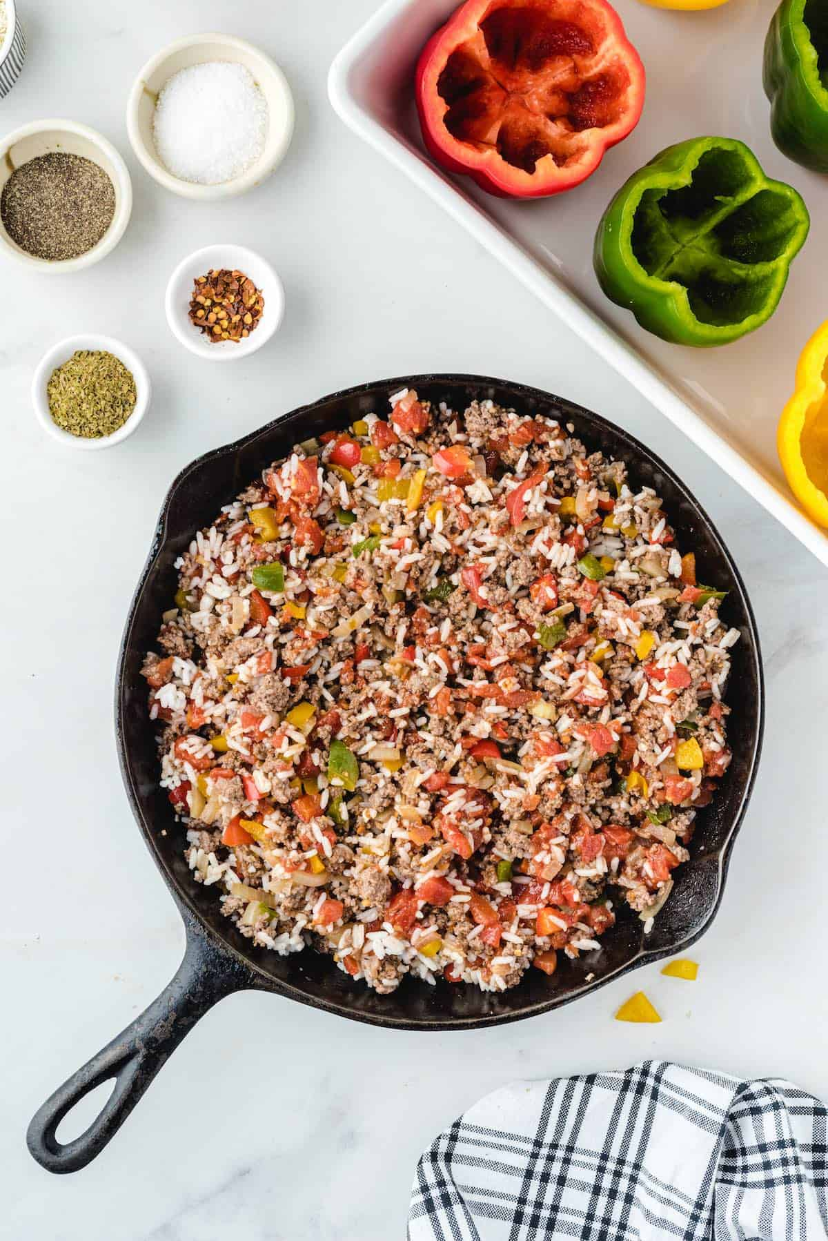 mixture of diced bell peppers, ground beef, rice in a pan