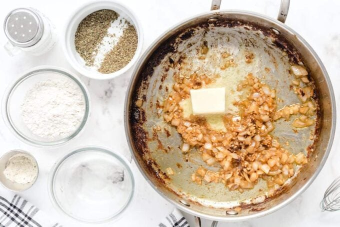 adding butter into the pan