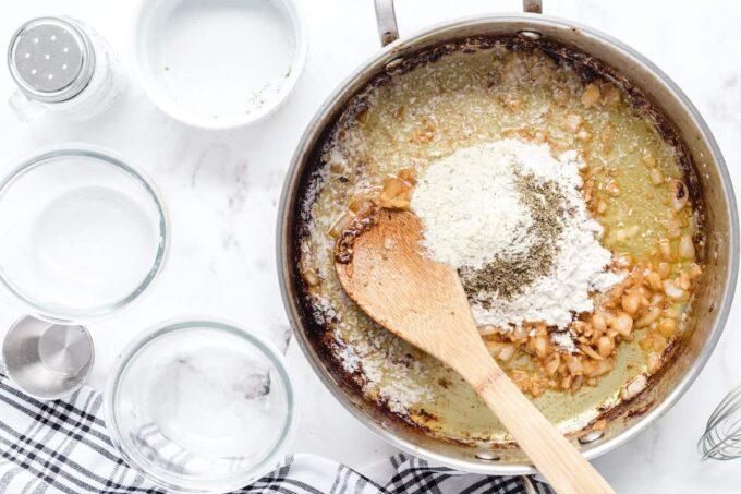 adding flour, Italian seasoning, basil, salt, and Ranch dressing