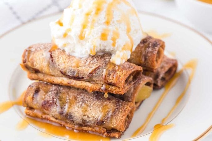 apple pie roll up on a plate with a scoop of ice cream