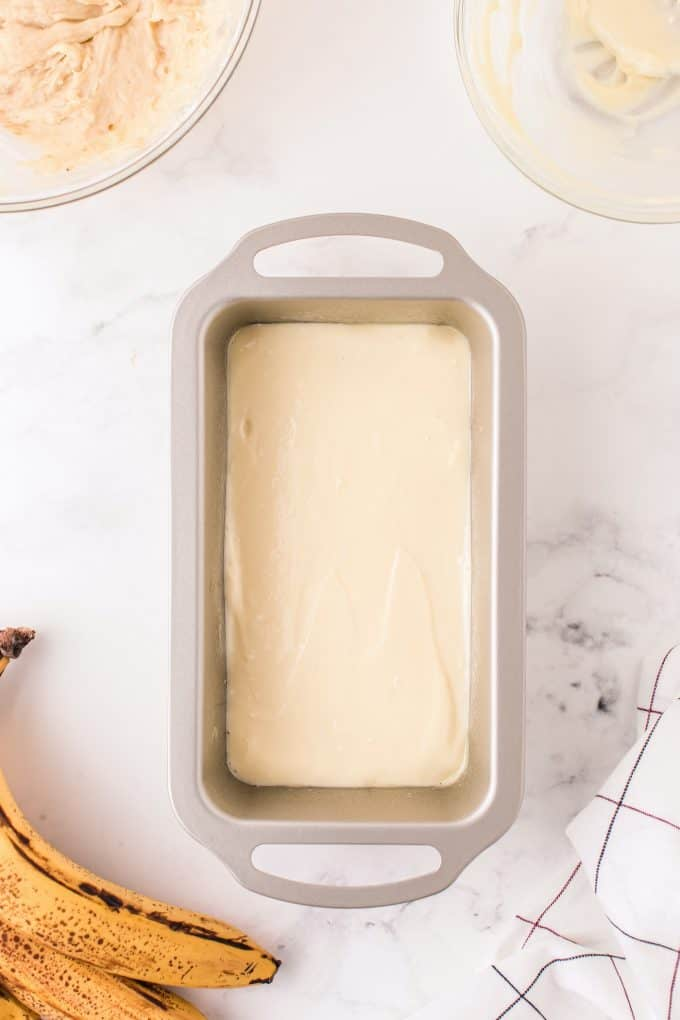 cream cheese mixture on top in a pan