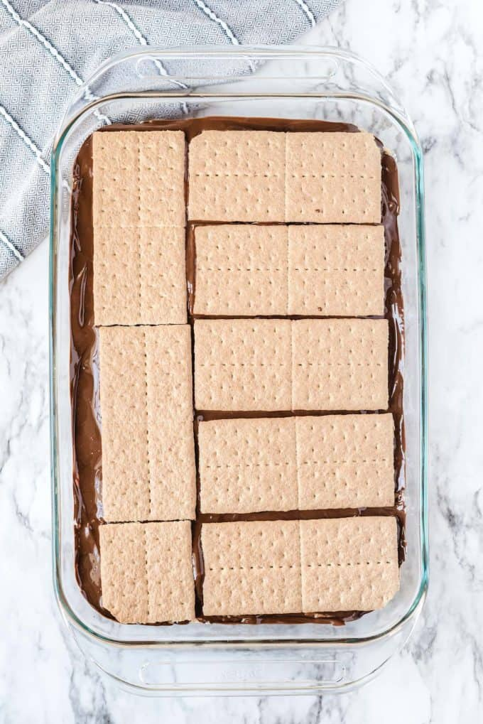 adding another chocolate layer and adding the graham cracker on top of it