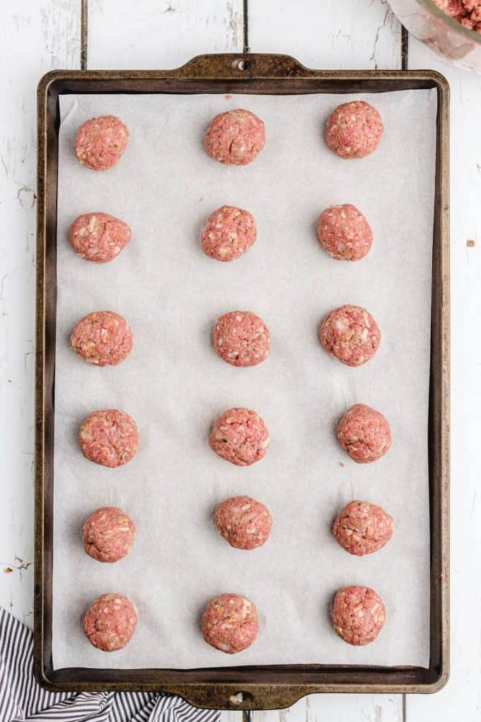 meatballs lined up in baking tray