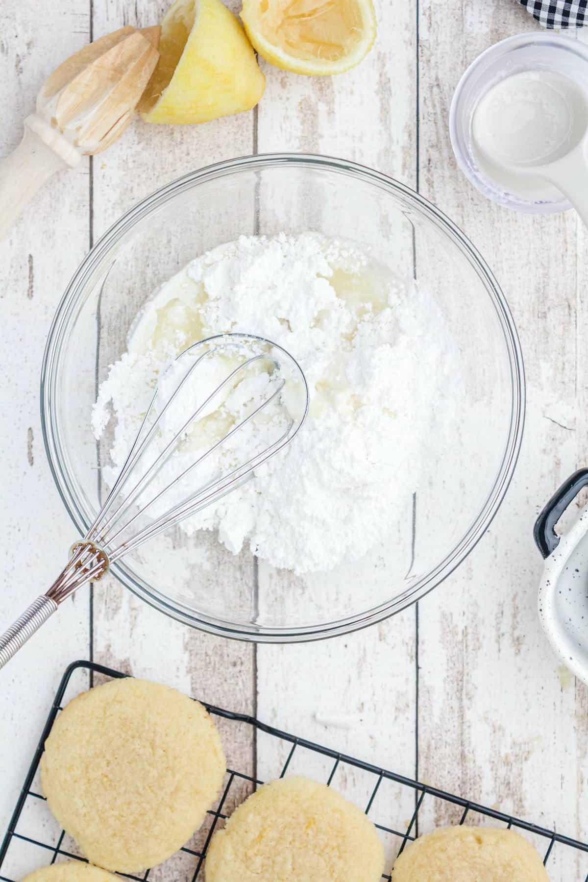 Mix together confectioner's sugar, lemon juice, and cream