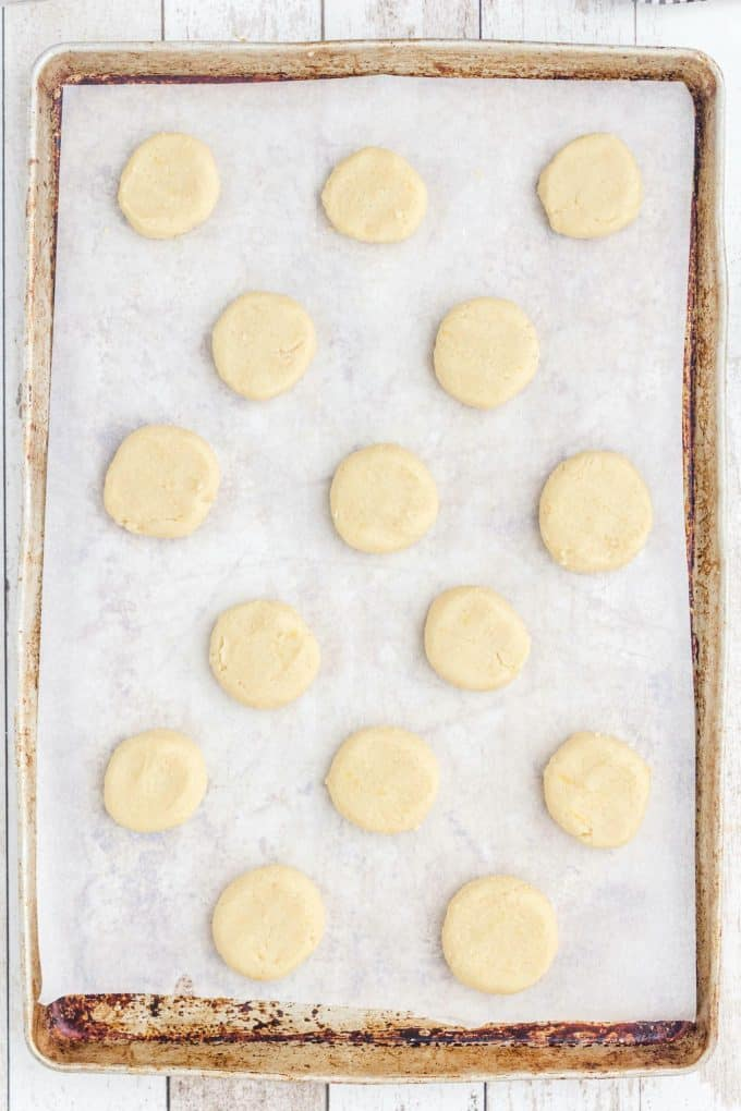 ball shaped dough on top of cookie baking sheet