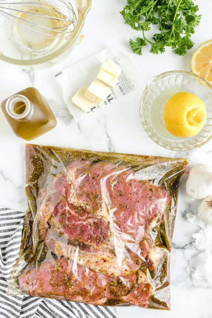steak and steak marinade in a ziplock bag