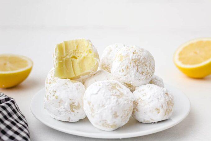 bitten white chocolate lemon truffles on a plate