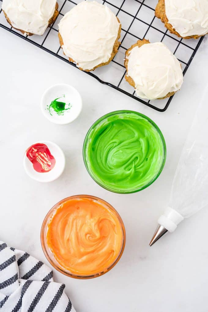 green and orange food colouring mixed with cream cheese frosting