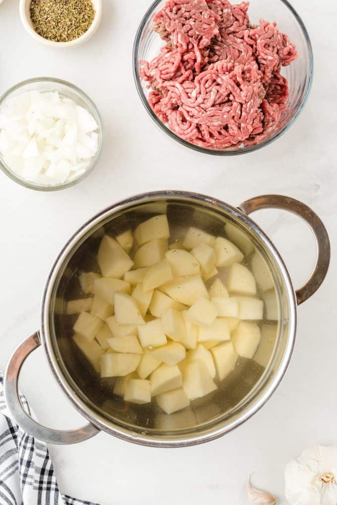 boiling potatoes in a pot