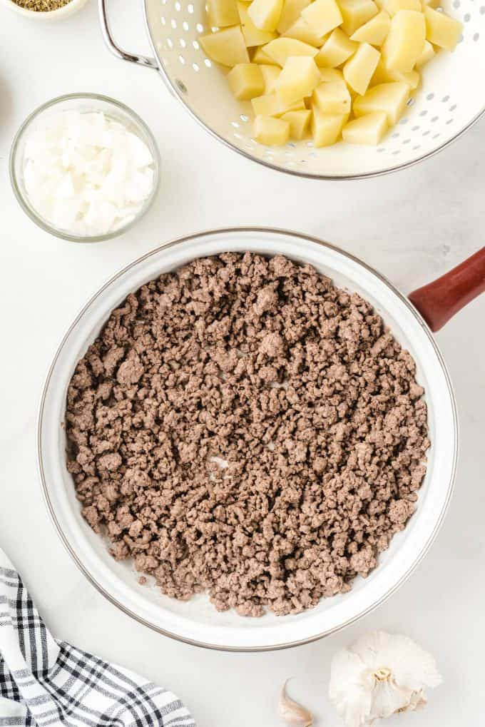 cooked ground beef in a pan
