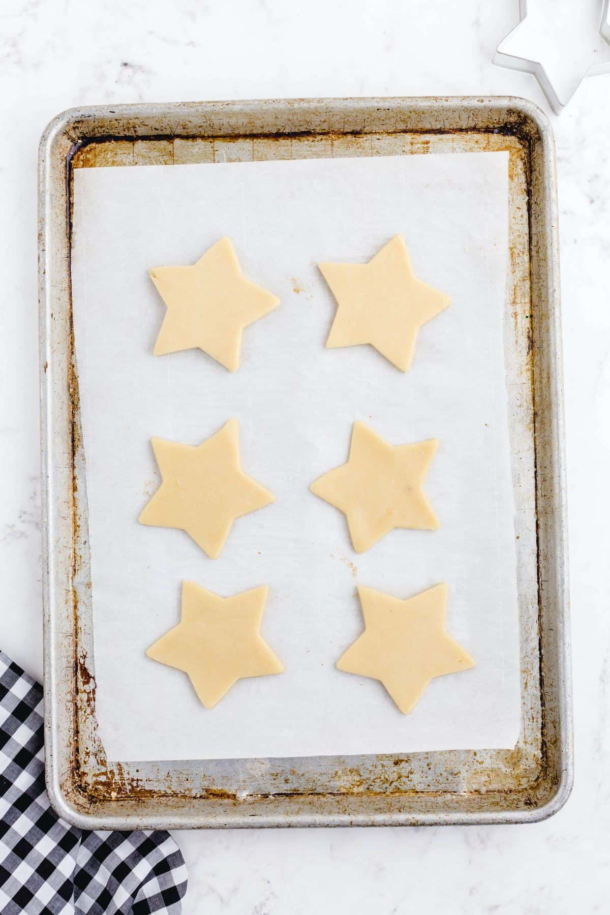 cut cookie dough into shape and put in baking pan