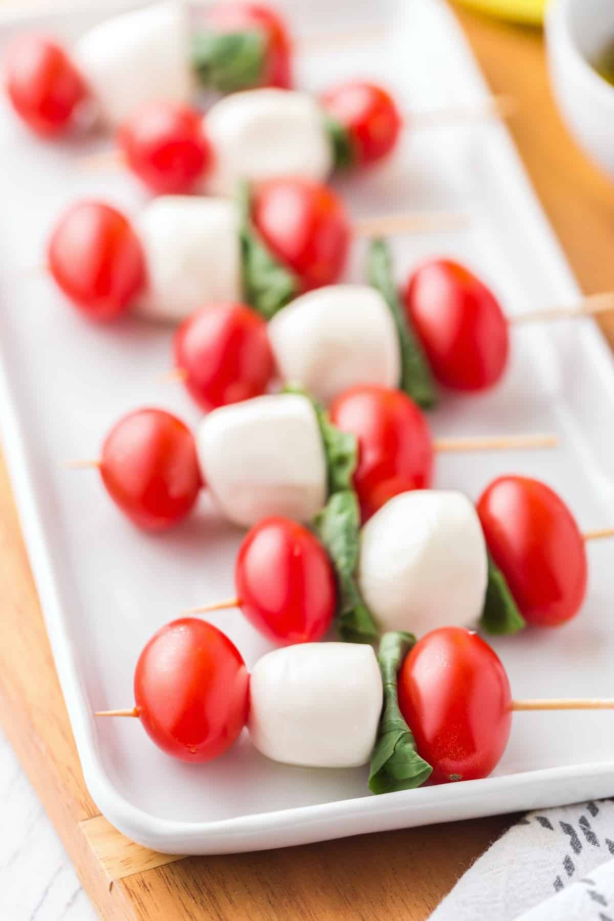 assemble tomato, mozzarella, and basil in a stick
