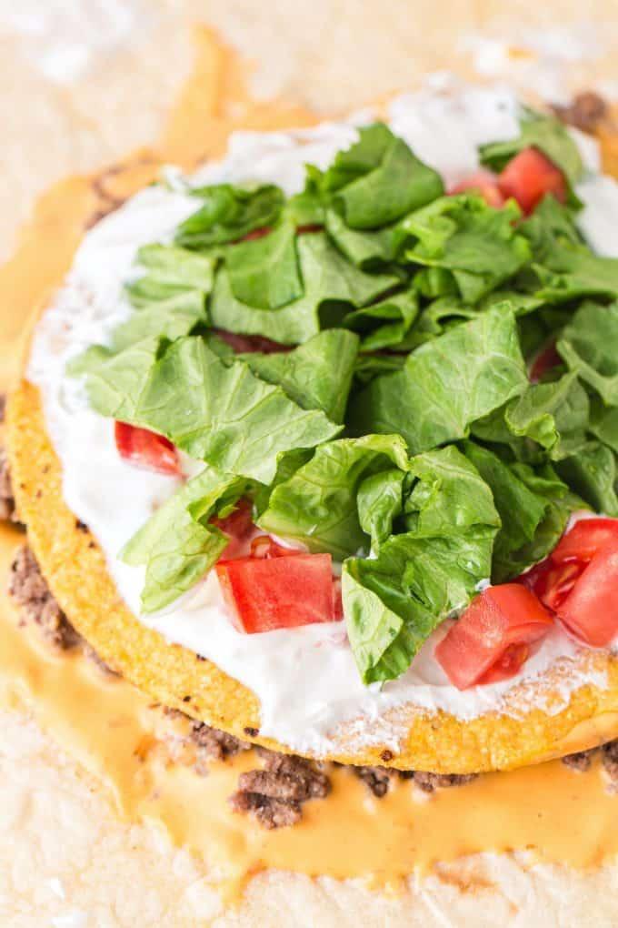 add sour cream, tomato and lettuce