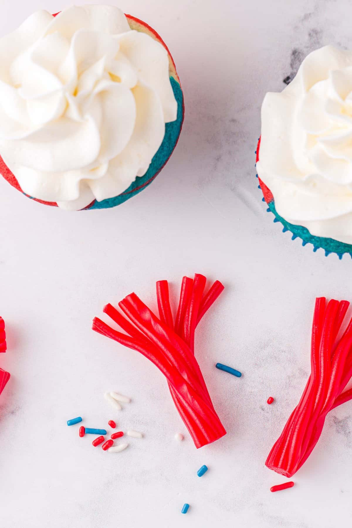 frost the cupcakes and peel licorice