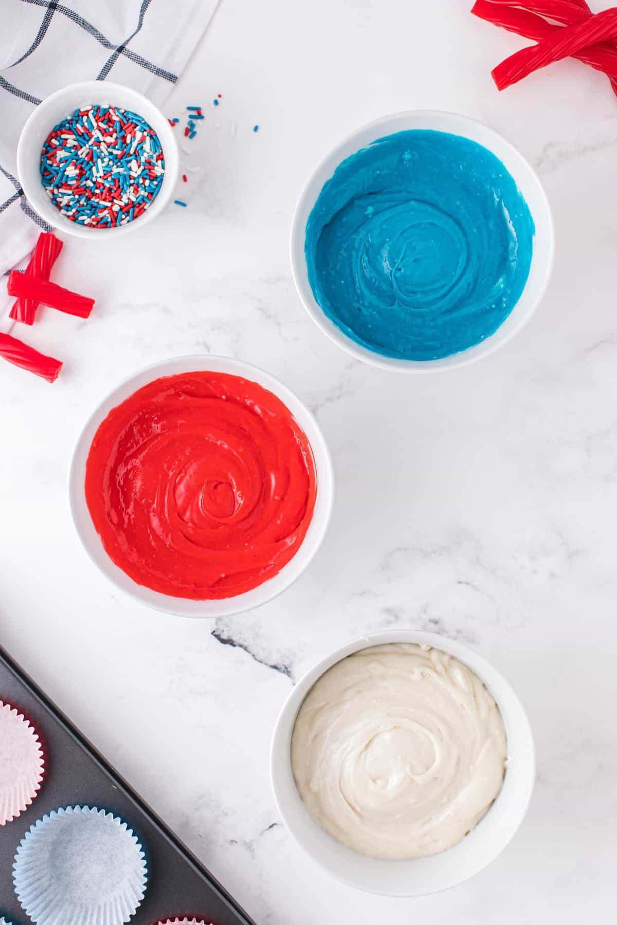 red blue and white cake in different bowl