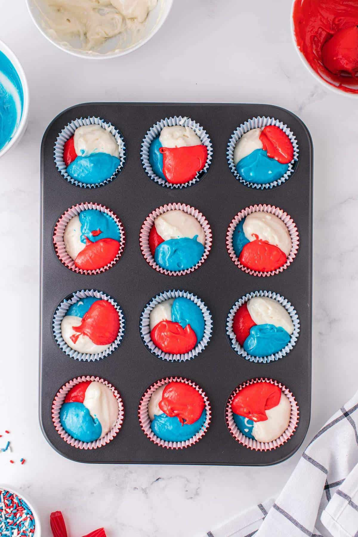 mix of red blue and white in each tin