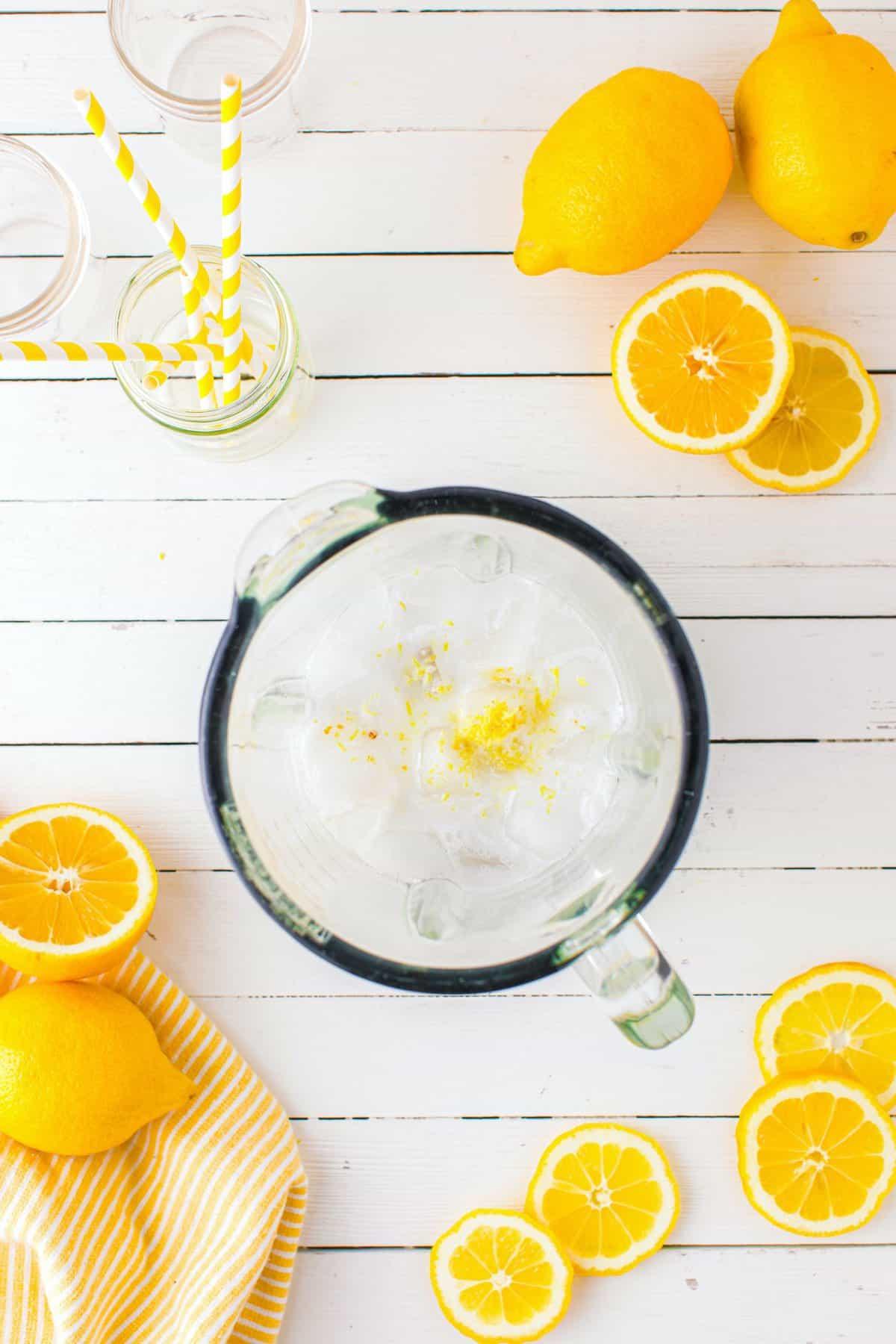 ice, coconut milk, lemon juice, zest, vanilla, and ginger in the blender