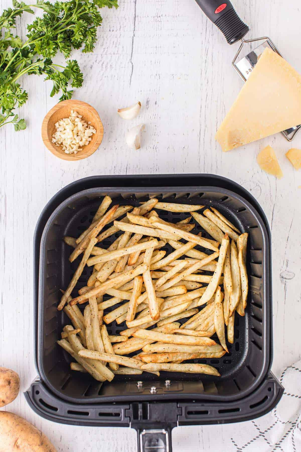 cooked fries in the air fryer basket