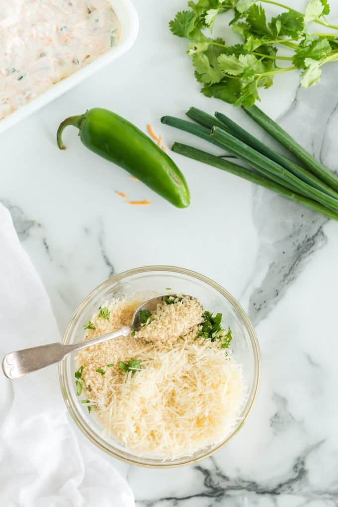 Combine the bread crumbs with the butter, parmesan cheese and parsley in a small bowl