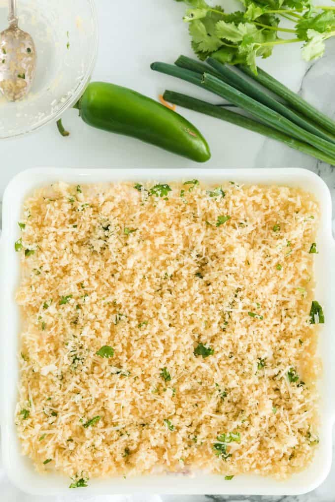 sprinkle the bread crumbs mixture on top of cream cheese