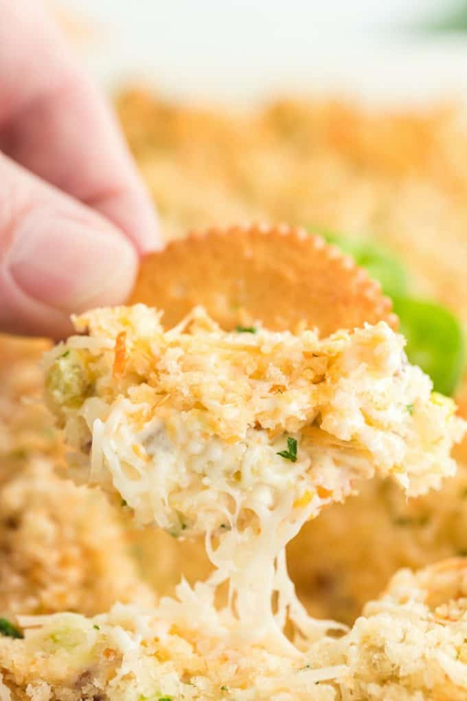 dipping crackers into the dip