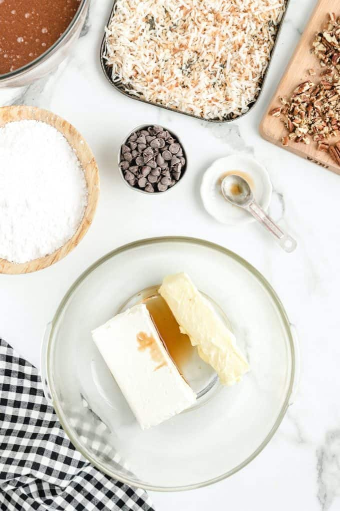 cream cheese, butter, and vanilla extract in a bowl
