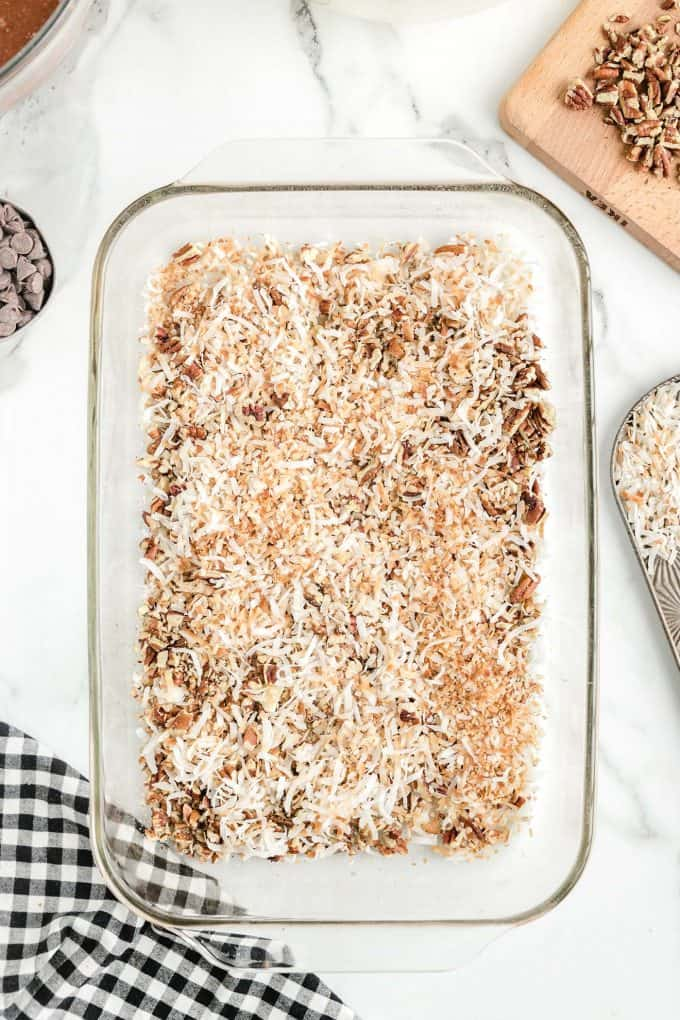 coconuts and pecans in a baking dish