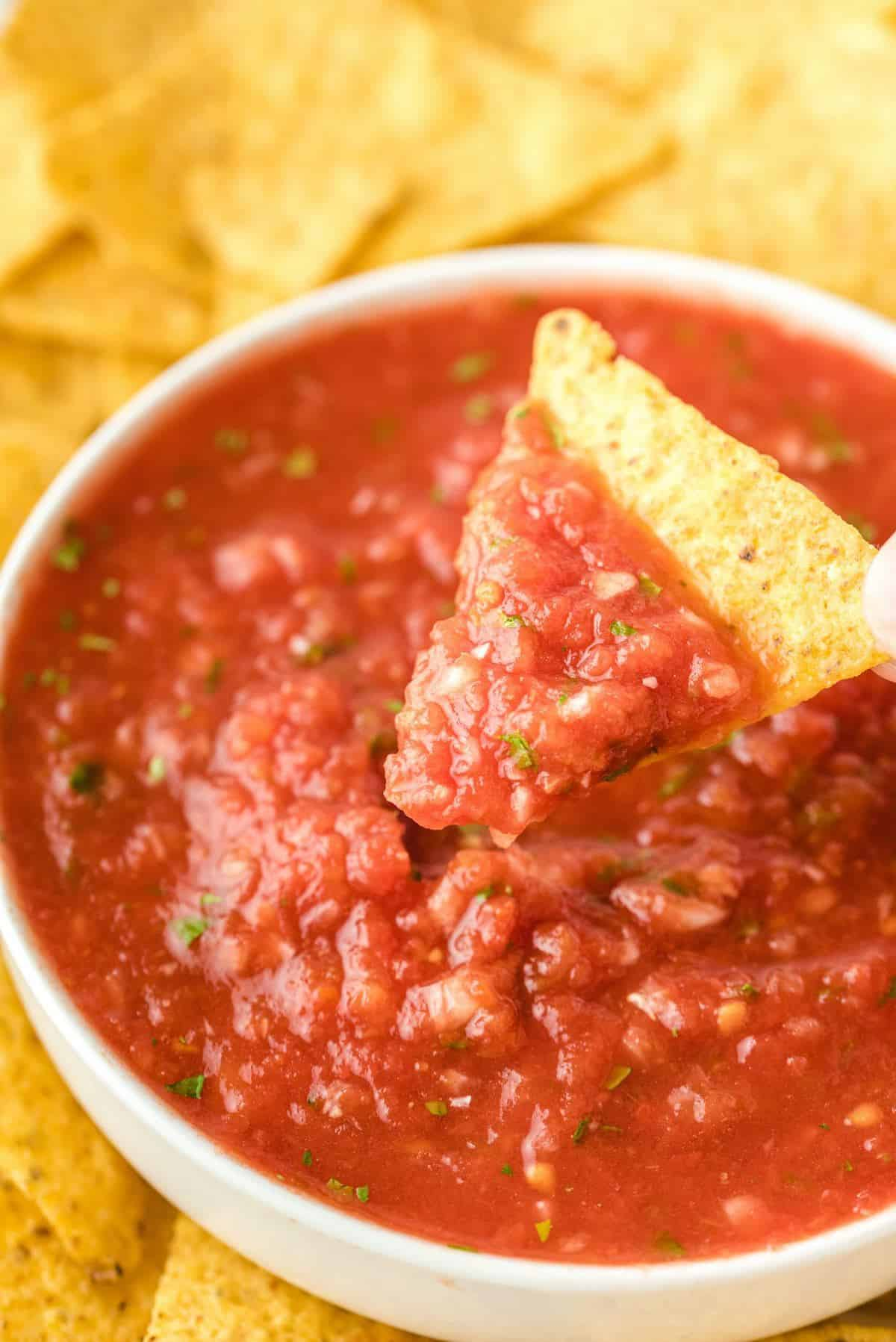 tortilla chips dipped in salsa