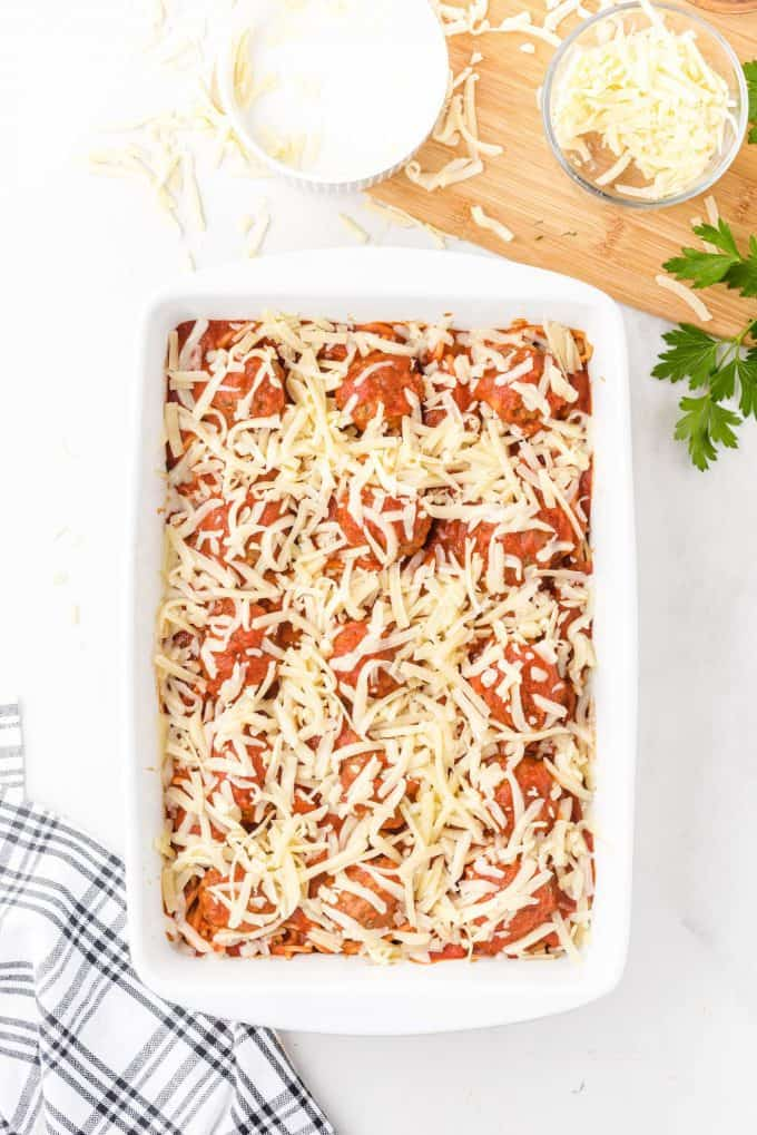 sprinkle cheese on top of the casserole