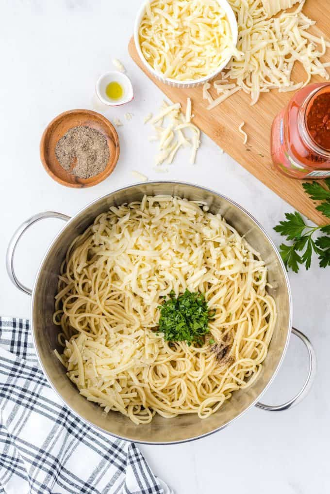 olive oil, cheese mixed with the cooked noodles
