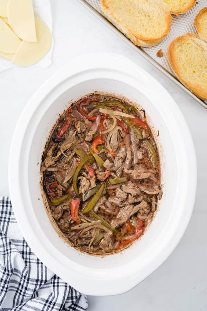 cooked beef strips, red and green peppers, and onions